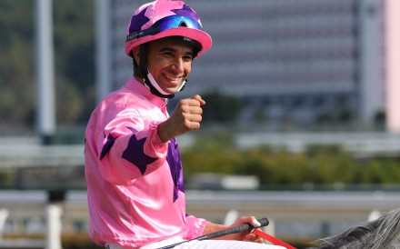 Joao Moreira celebrates his Group One victory aboard Hot King Prawn on Sunday. Photos: Kenneth Chan