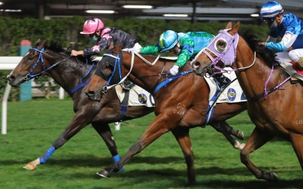 Keith Yeung drives The Anomaly (left) to victory at Happy Valley on Wednesday night. Photo: Kenneth Chan
