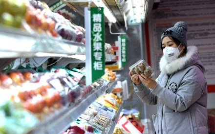 A woman shops at a supermarket in Shijiazhuang, Hebei province, on January 31. China must beware the risks of imported inflation from food, energy and raw materials. Photo: Xinhua