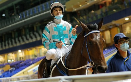 Joao Moreira gives the thumbs up after saluting aboard Daily Beauty at an empty Happy Valley on Wednesday night. Photos: Kenneth Chan