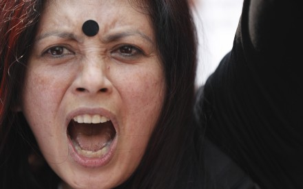 An activist at a protest rally in Kathmandu. Hundreds of women's right activists and their supporters rallied in Nepal's capital in February to call for an end to violence and discrimination against women. Photo: AP