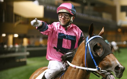 Alfred Chan enjoys his win aboard Land Power at Happy Valley on Wednesday night. Photos: Kenneth Chan