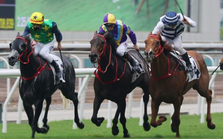 Matthew Poon drives Butterfield to victory in the Group Three Queen Mother Memorial Cup at Sha Tin on Sunday. Photos: Kenneth Chan