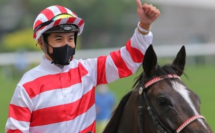 Derek Leung celebrates his victory aboard Love Me More at Sha Tin on Sunday. Photos: Kenneth Chan