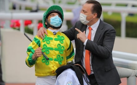 Jockey Joao Moreira and trainer Caspar Fownes celebrate their Derby win with Sky Darci in March. Photo: Kenneth Chan