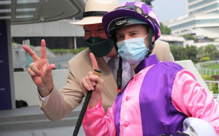 Zac Purton and David Hayes celebrate the jockey's 1,300th Hong Kong winner. Photos: Kenneth Chan