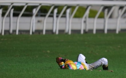 Karis Teetan lies on the turf after a heavy fall at Happy Valley on Wednesday night. Photos: Kenneth Chan