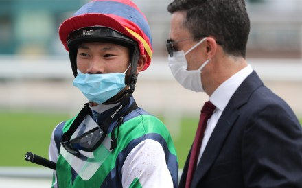 Jockey Jerry Chau and trainer Douglas Whyte discuss a winner earlier this season. Photos: Kenneth Chan