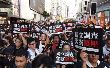 Thousands of people are taking part in an annual march through downtown Hong Kong on the anniversary of the former British colony's 1997 handover to Chinese sovereignty. 