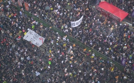 Tens of thousands of people are taking part in an annual march in Hong Kong on the anniversary of the former British colony's 1997 handover to Chinese sovereignty. 