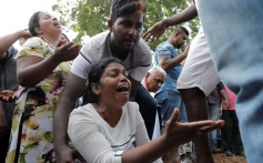 Mourners react during a mass burial of victims, two days after a string of suicide bomb attacks on churches and luxury hotels across the island on Easter Sunday, in Colombo, Sri Lanka April 23, 2019. REUTERS/Dinuka Liyanawatte