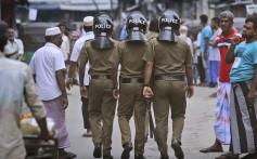 Policemen patrol a Muslim neighbourhood before Friday prayers in Colombo, Sri Lanka. Photo: AP