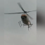 A helicopter swoops over a marathon and blows all the advertising onto the course