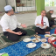 Malaysia's Deputy Health Minister Noor Azmi Ghazali was criticised after sharing on Facebook this picture of him sharing a meal with about 30 students. He has since deleted the picture. Photo: Facebook