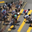 Primary school pupils cross the road at the end of school in Tsuen Wan. Photo: Felix Wong