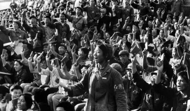 "Hundreds of Red Guards, a propaganda squad made mostly of high school and university students, brandishing copies of the ""Little Red Book"", a collection of Mao Zedong quotes, at a rally in 1966."