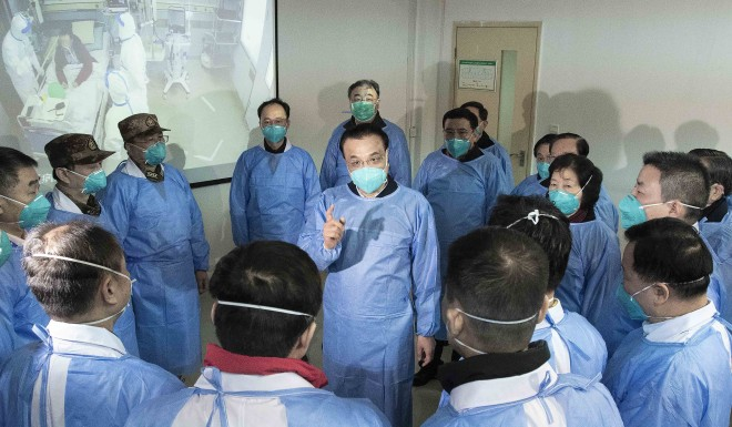Chinese Premier Li Keqiang meets with medical workers in Wuhan on January 27, 2020. A political analyst said Xi could be trying to distance himself from the mishandling of the coronavirus outbreak.