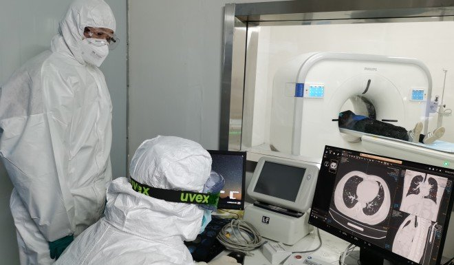 Doctors check the CAT image of a coronavirus patient's lungs at Leishenshan Hospital in Wuhan.