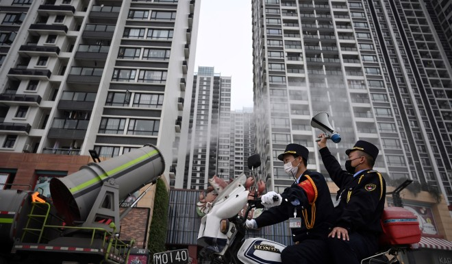 The southern city of Guangzhou has deployed mist cannons to sanitize public spaces.