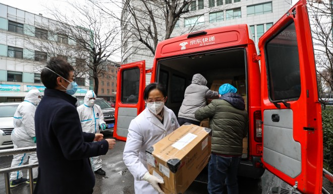 A hospital in Wuhan unloads medical supplies sent from the eastern Chinese province of Jiangsu.