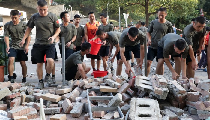 PLA soldiers sent onto Hong Kong streets to help clear roadblocks