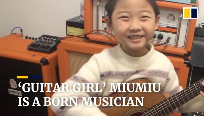 'Guitar girl' Miumiu, 6, is a born musician