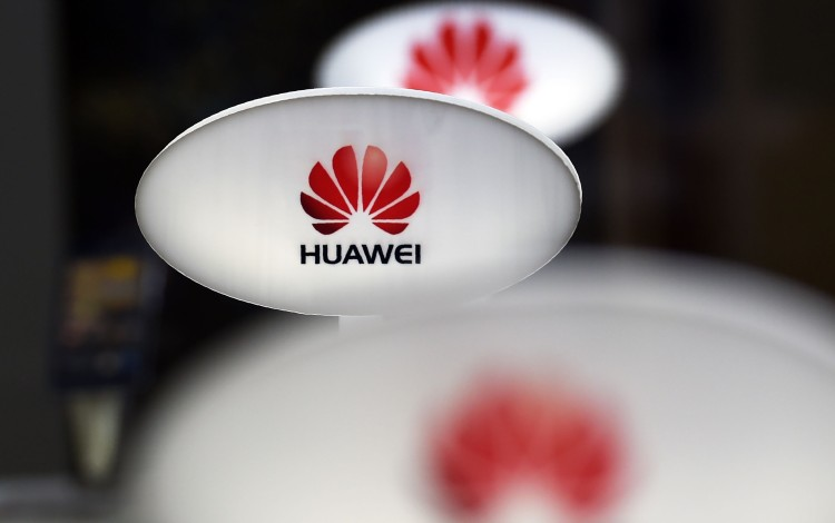 Beijing's Top Official In Hong Kong Taunts Washington Over Huawei Executive's Arrest, Calling It 'world's Biggest Advertisement'