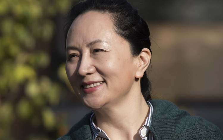 Huawei chief financial officer Meng Wanzhou leaves her home to attend the third day of a court hearing in Vancouver on Wednesday. Photo: The Canadian Press via AP