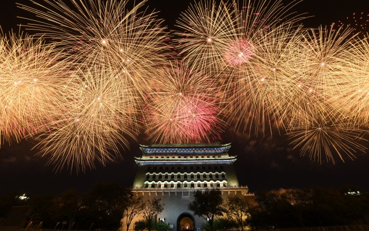 Fireworks light up the night sky during a gala show in Beijing on Tuesday. Photo: Xinhua