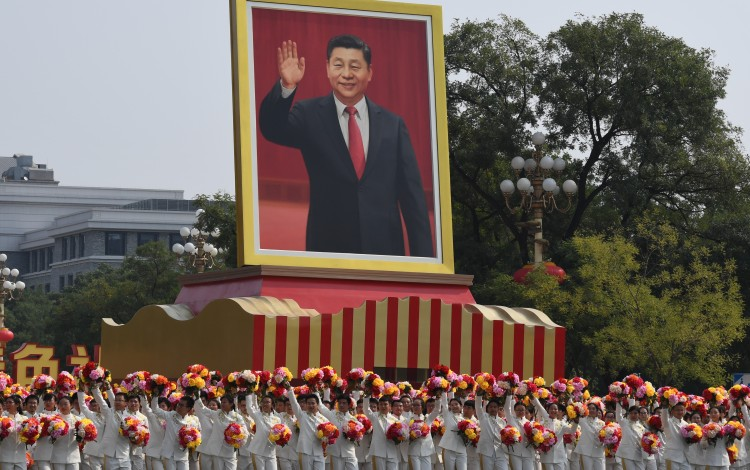 A portrait of Xi Jinping is displayed in the National Day mass pageantry in Beijing on Tuesday celebrating the 70th anniversary of the People\'s Republic of China. Photo: Xinhua