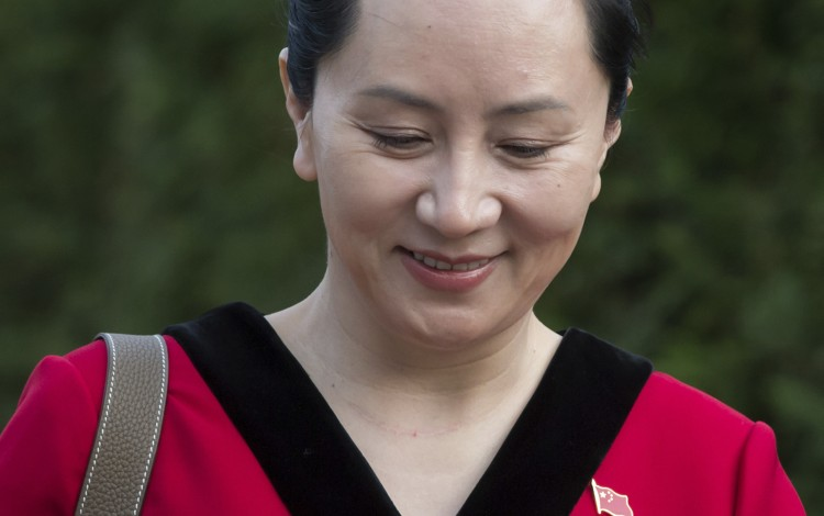 Meng Wanzhou on Tuesday, which is National Day in China. She wears a Chinese flag pin on her dress. Photo: The Canadian Press via AP