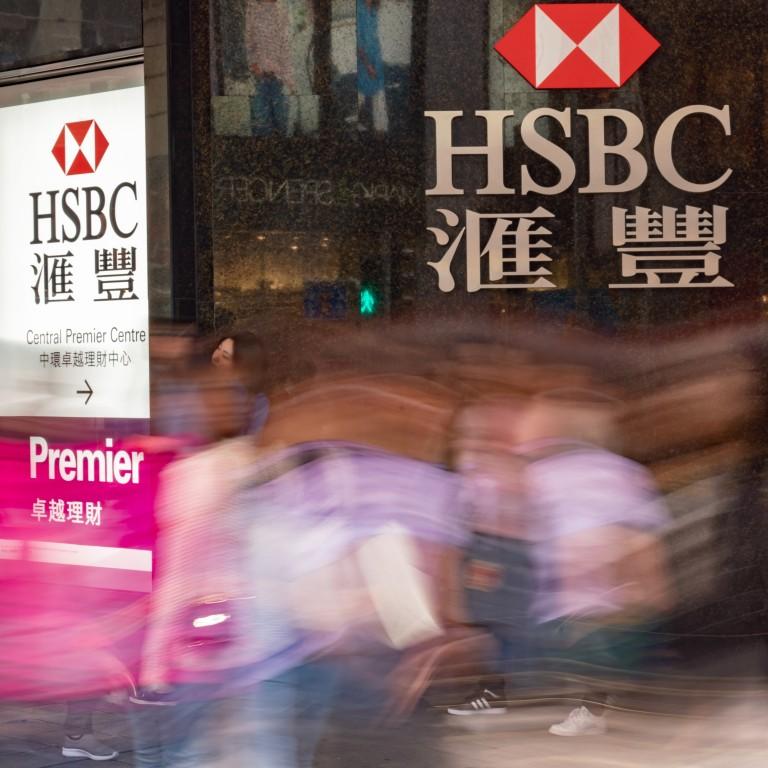 Pedestrians walk past an HSBC bank branch in Central, Hong Kong. Photo: Bloomberg