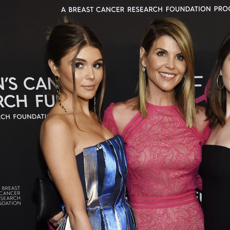 217be0b1138 Actress Lori Loughlin poses with daughters Olivia Jade Giannulli (left) and Isabella  Rose Giannulli
