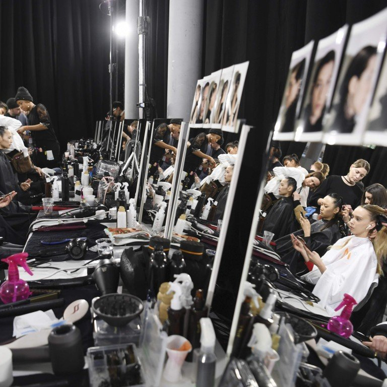 9b1be042d18 Models prepare backstage before the Shiatzy Chen autumn winter 2019 20  collection show at