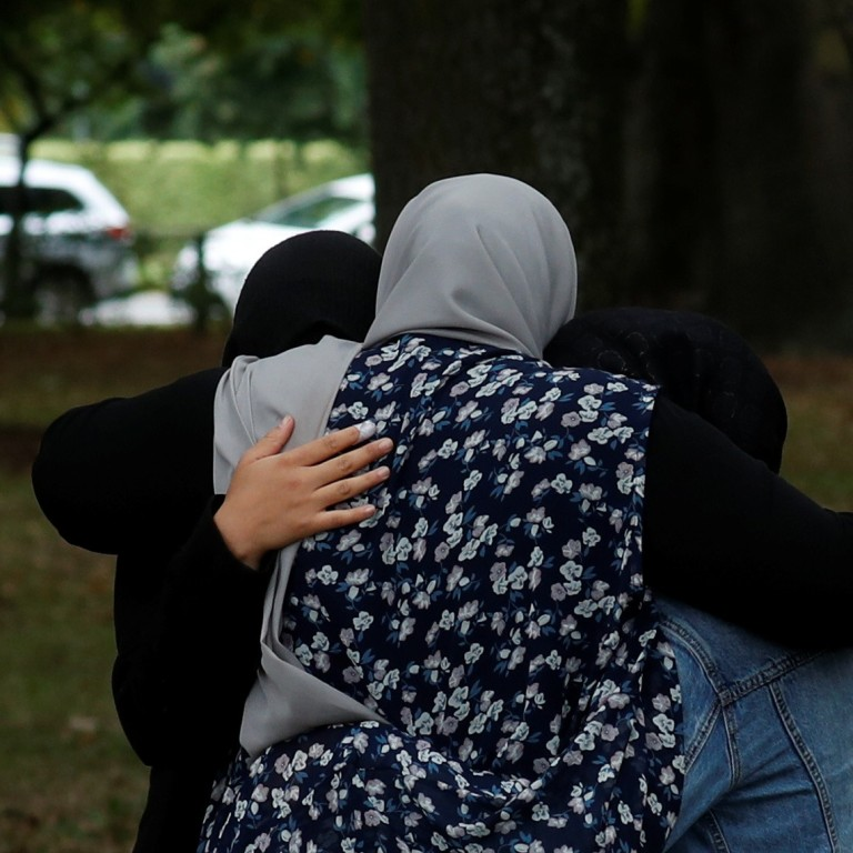 best website dc96e 1e8b5 People embrace near Masjid Al Noor mosque in Christchurch, New Zealand.  Photo  Reuters