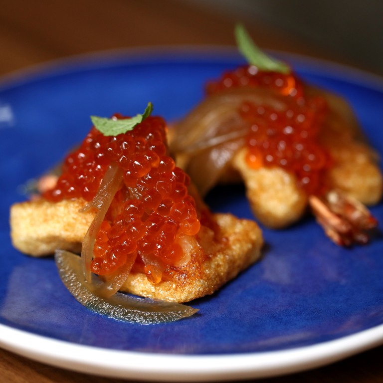 a7757df98b4 Shrimp toast with house pickled onions and salmon roe at Roots restaurant  in Wan Chai.