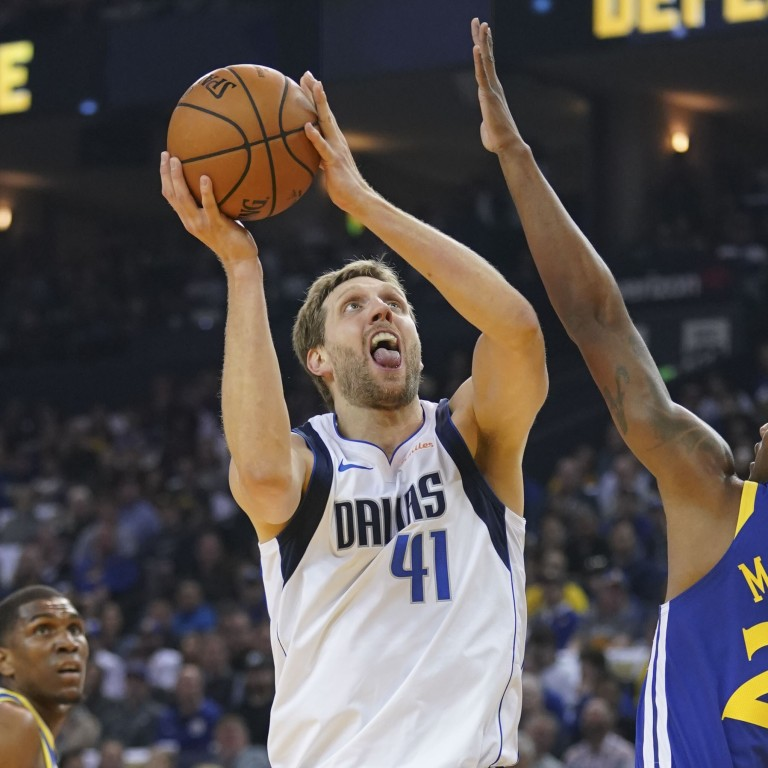 sports shoes 3cb70 65b4e Dallas Mavericks forward Dirk Nowitzki was integral to his side s victory  over the Golden State Warriors