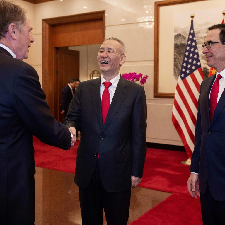 China's Vice Premier Liu He (centre) shake hands with US Trade Representative Robert Lighthizer (left) as US Treasury Secretary Steven Mnuchin (right) looks on in Beijing in March. Photo: AFP