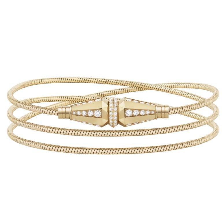 800906ab2633 Jack de Boucheron s three wraps bracelet is half-paved with diamonds in  yellow gold.