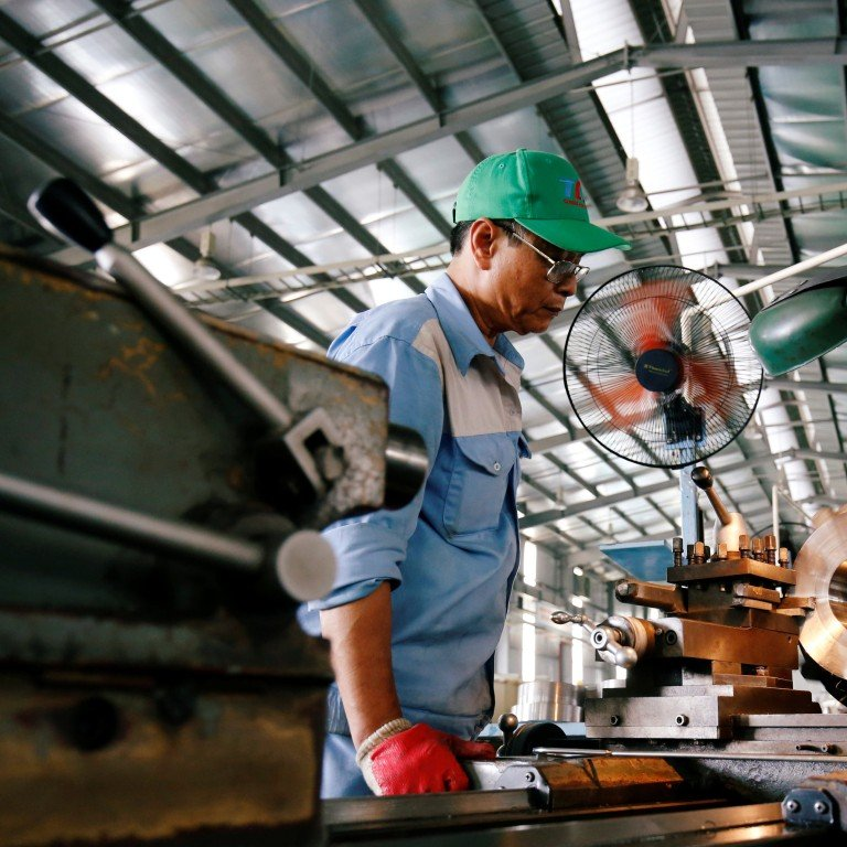 73ecf4a1435 A man works at a mechanical factory in Hanoi. Photo  Reuters
