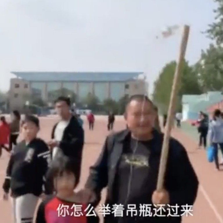 c82c926eaf Chinese father takes daughter, 10, to top school's open day despite her  being on an IV drip