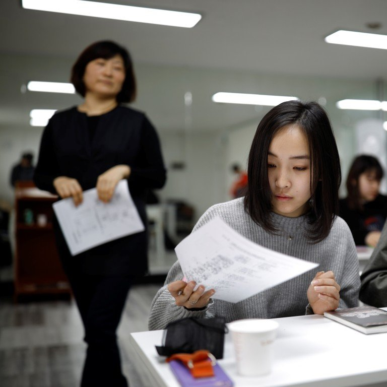 0939ac5d In most of Japan's public schools, pupils are only permitted to have  straight black hair