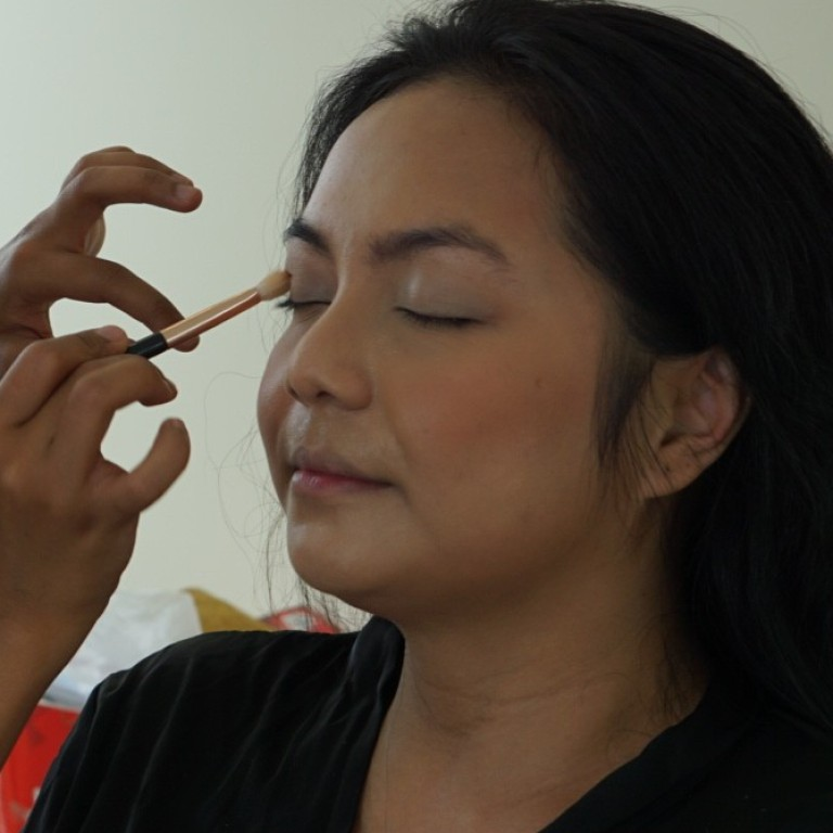 0b77f21d0 Malaysian make-up artist Jia works on one of her clients. Unlike most