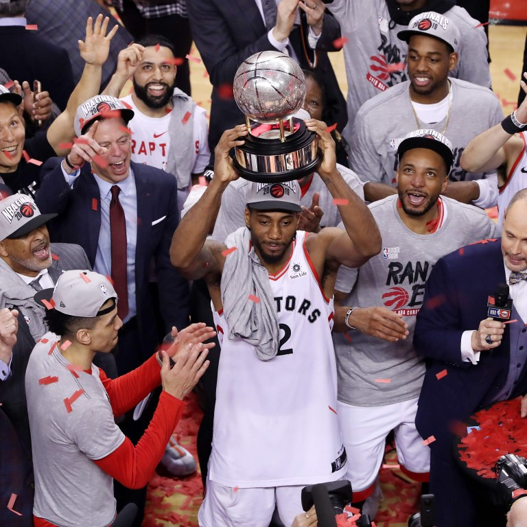 033a3122731 Kawhi Leonard of the Toronto Raptors celebrates with the Eastern Conference  trophy after defeating the Milwaukee