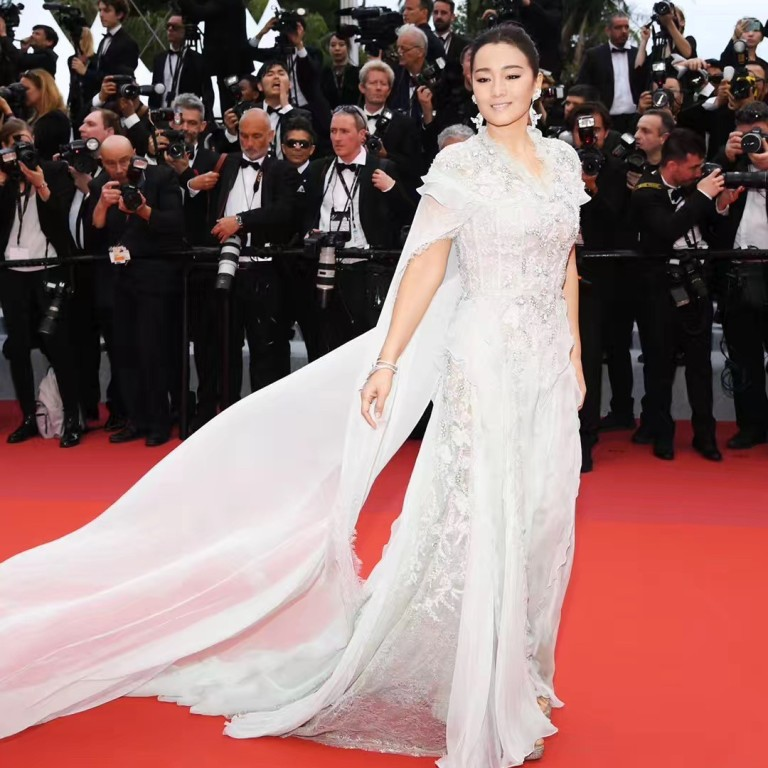 5fc572fd20c4 Gong Li shows off Boucheron's gems as she walks the opening red carpet at  this Cannes