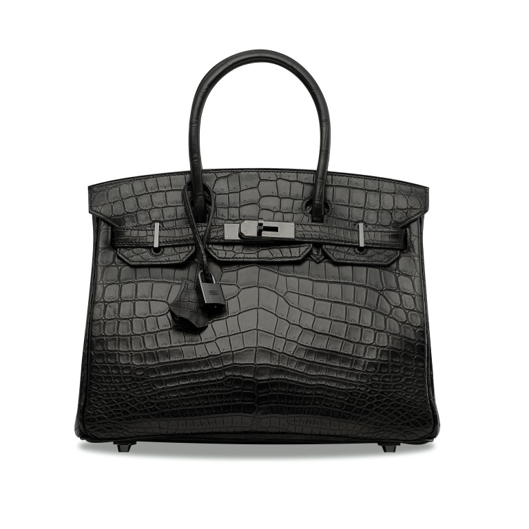 71be65cb9935 A Hermès So Black series handbag of the same design as one that sold for a