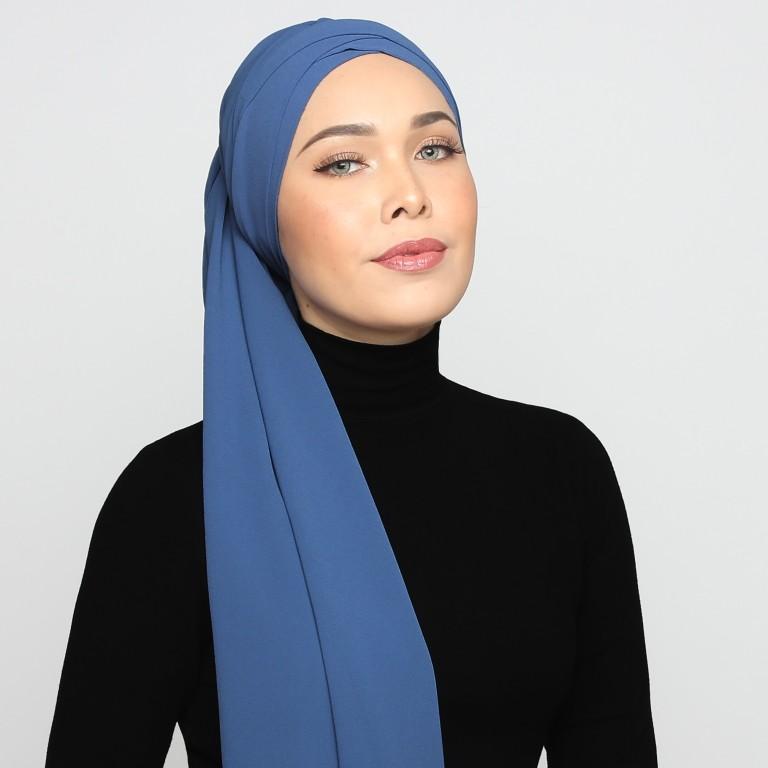 9dcfa558a16c7 Fashion stylist turned modest-wear entrepreneur Adlina Anis wears a hijab.  She is one