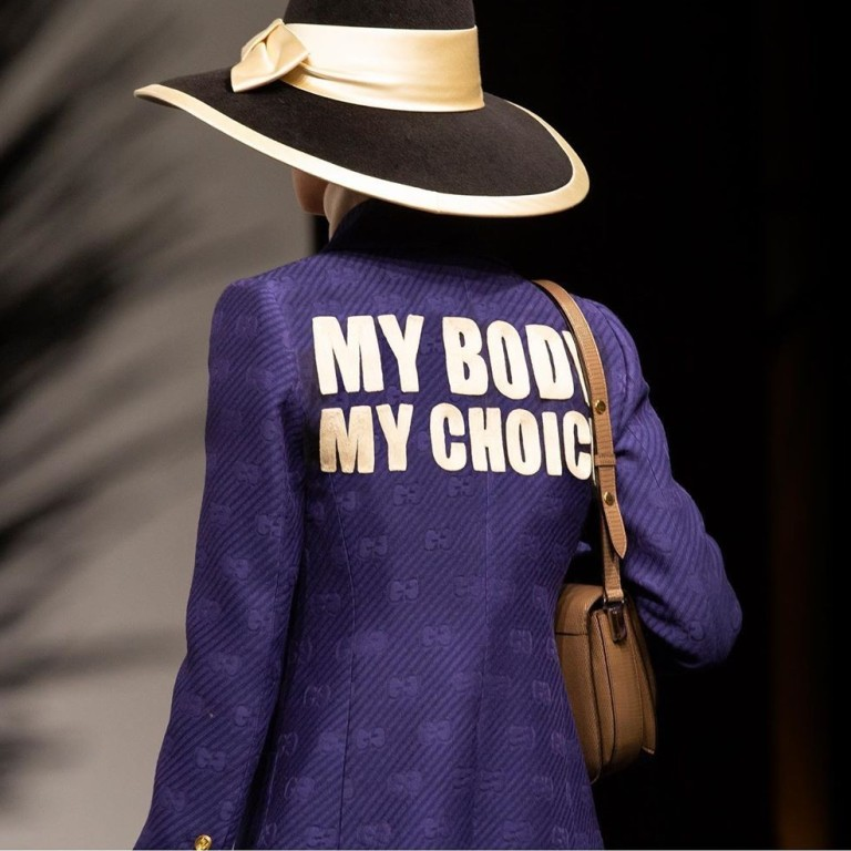 c5bc3974d A runway model wears a purple jacket with the abortion rights message, 'My  Body