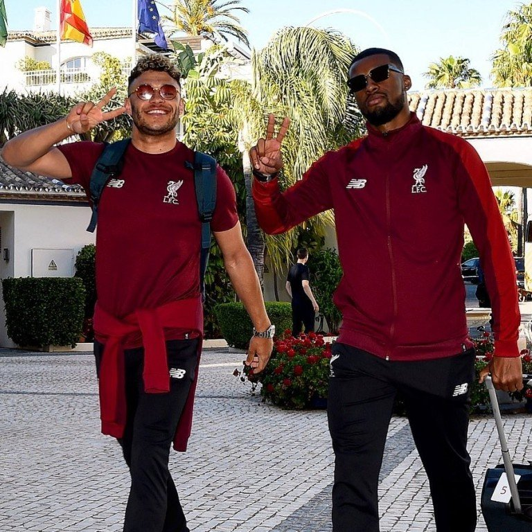 c6df5295 Liverpool players Alex Oxlade-Chamberlain and Georginio Wijnaldum greet the  press photographers in Spain as