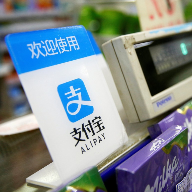 1b51cbbbf5eae The logo of Alipay, the payments business of Ant Financial Services, is  seen at